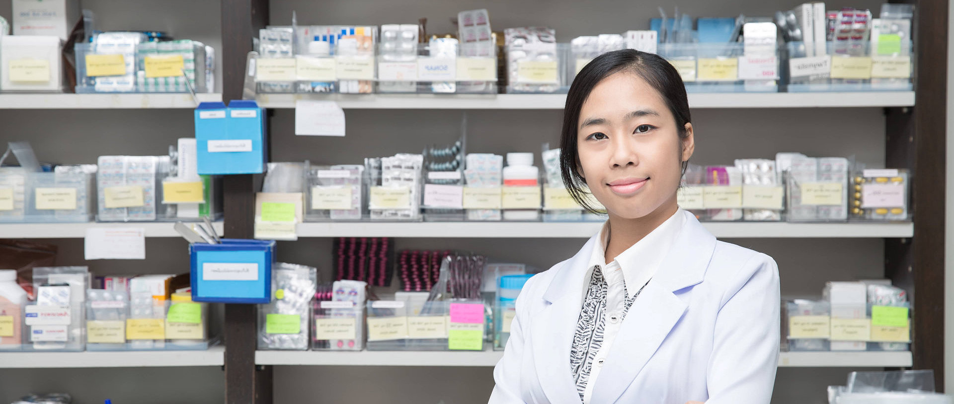 female pharmacist standing