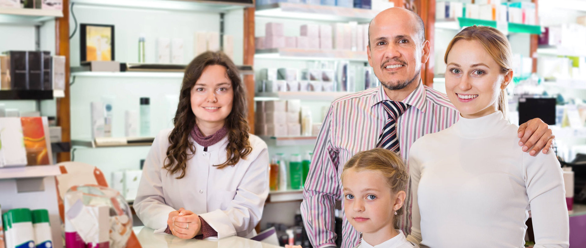 happy family visiting a pharmacy